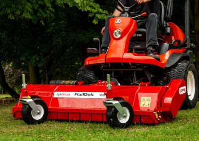 Designed to expel debris in a downward direction behind the mower to ensure safety in public